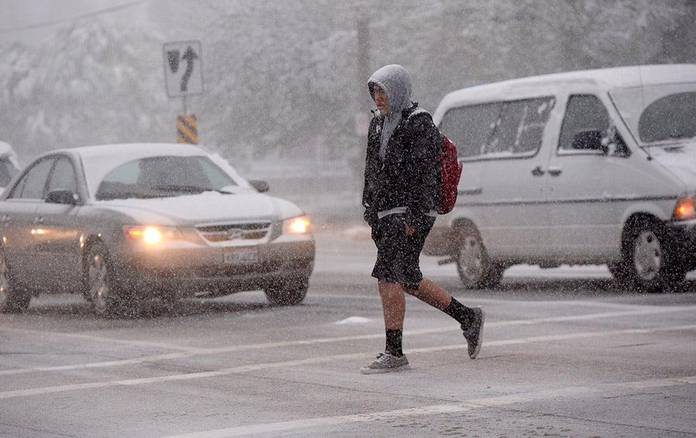 A Highland High School student walks to school Wednesday, April 15, 2015, in Salt Lake City.