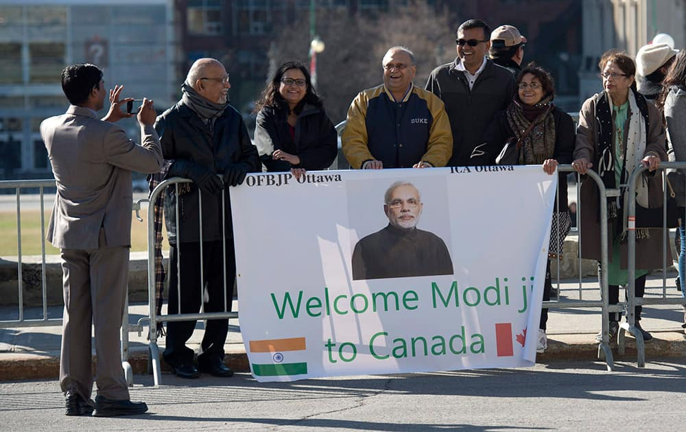 Supporters wait for Prime Minister Narendra Modi to arrive on Parliament Hill in Ottawa.
