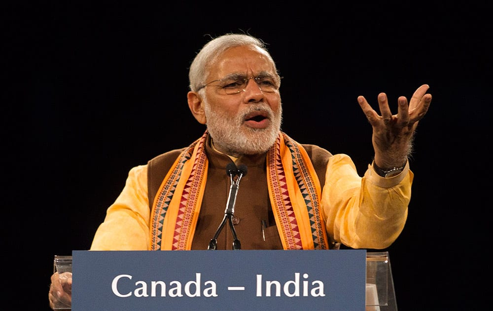 Prime Minister Narendra Modi addresses the crowd during an event in Toronto.