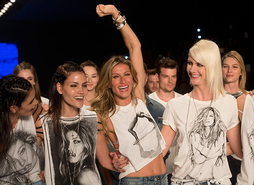 Brazilian supermodel Gisele Bundchen, cheers at the end of the show from the Colcci Summer collection at Sao Paulo Fashion Week in Sao Paulo, Brazil.