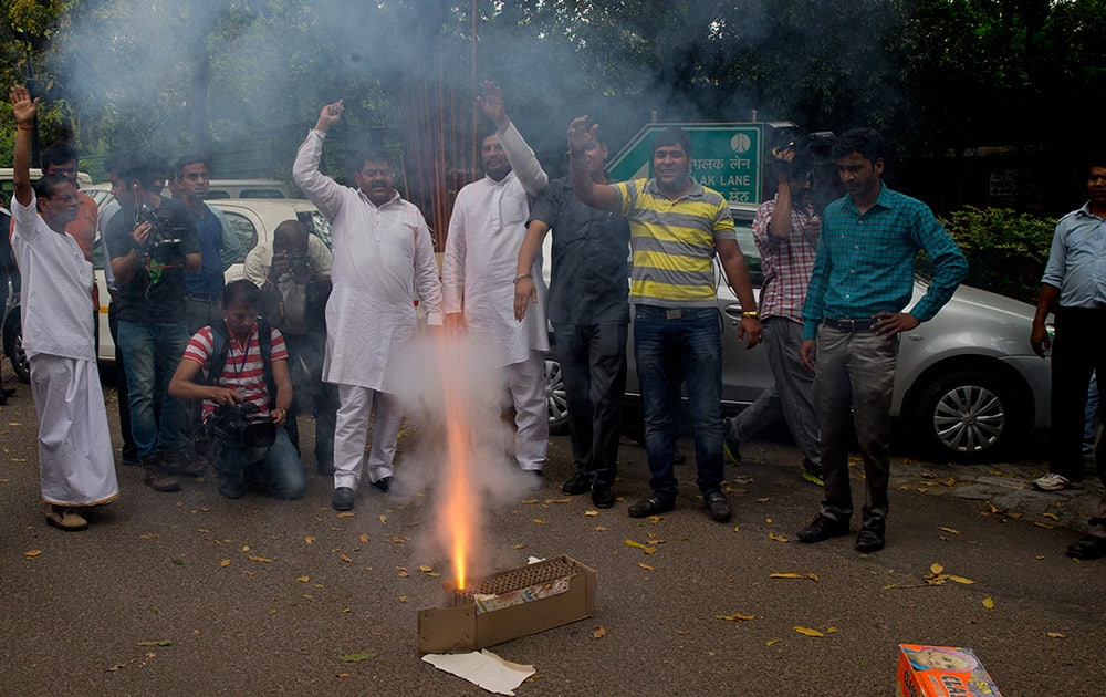 Congress party supporters light crackers outside the residence of their leader Rahul Gandhi as they celebrate his return from holidays in New Delhi.