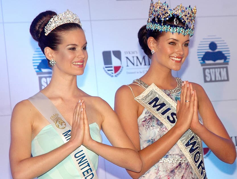 Miss World 2014 Rolene Strauss with Miss England 2014 Carina Tyrrell (L) at a press conference in Mumbai.
