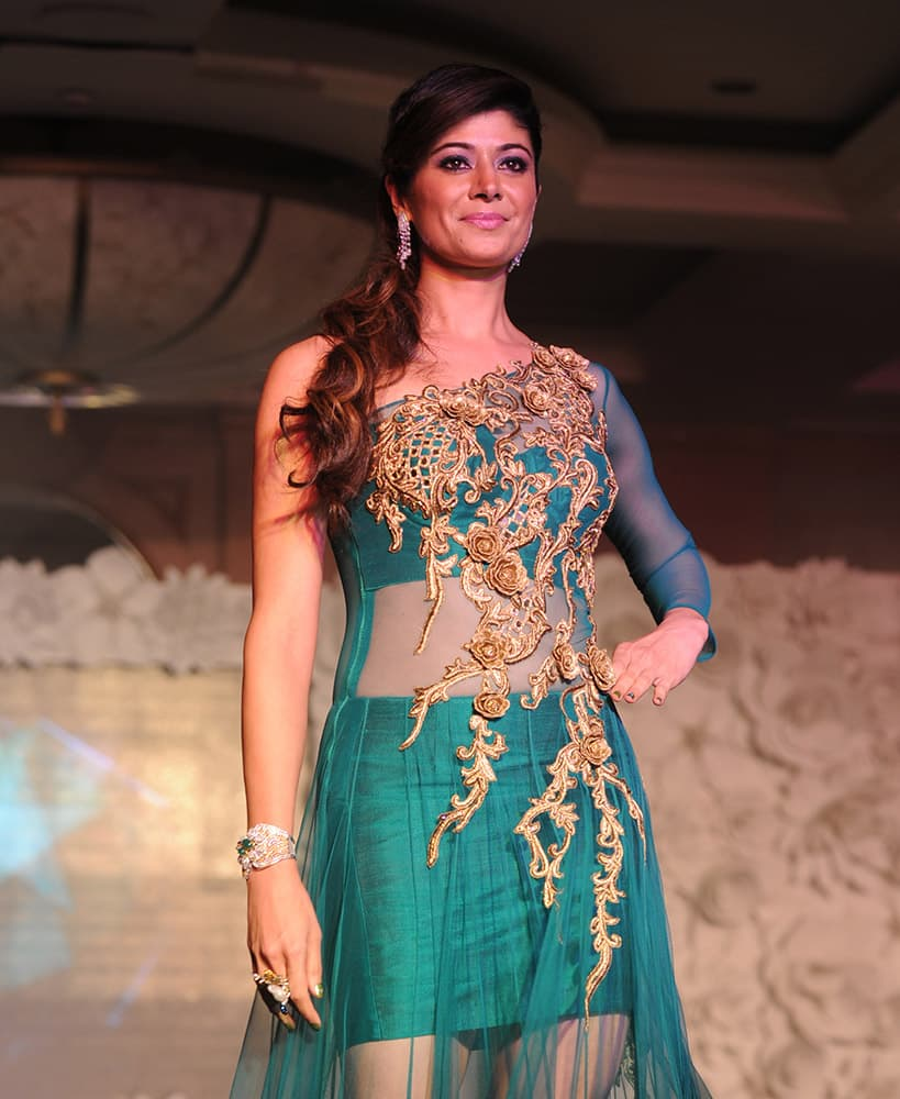 Pooja Batra walks the ramp at a fashion show organised for the cause of stopping girl child abuse, in collaboration with NGO Beti in Mumbai. DNA