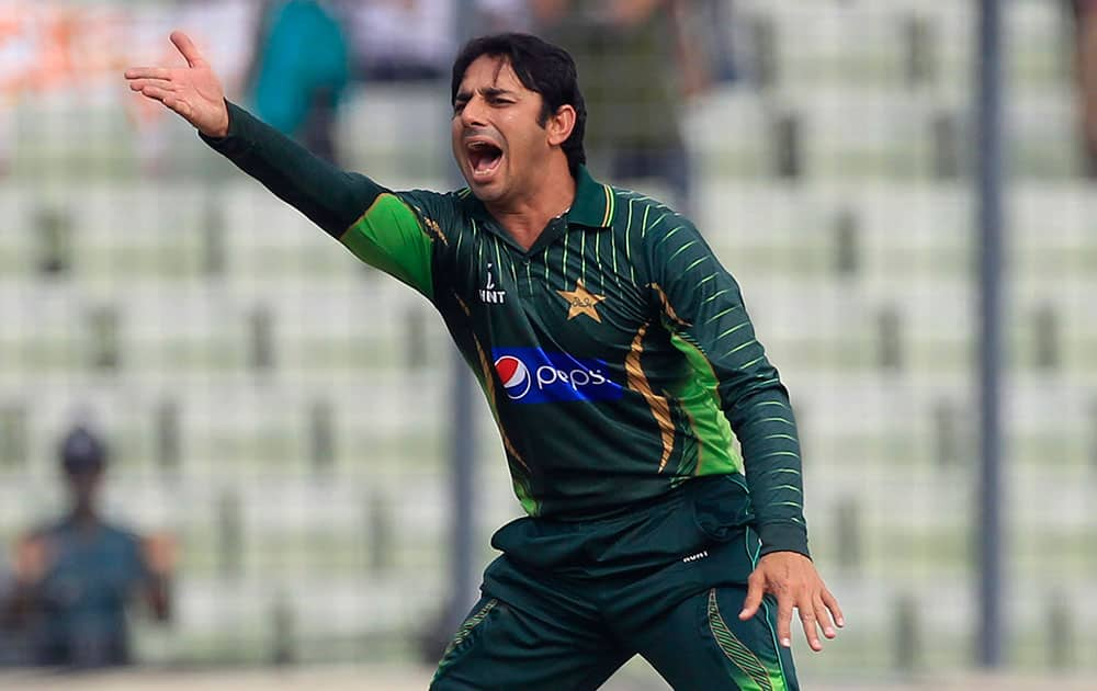 Pakistan's Saeed Ajmal reacts after Bangladesh's Tamim Iqbal played a shot off his bowling during their first one-day international cricket match against Bangladesh, in Dhaka.