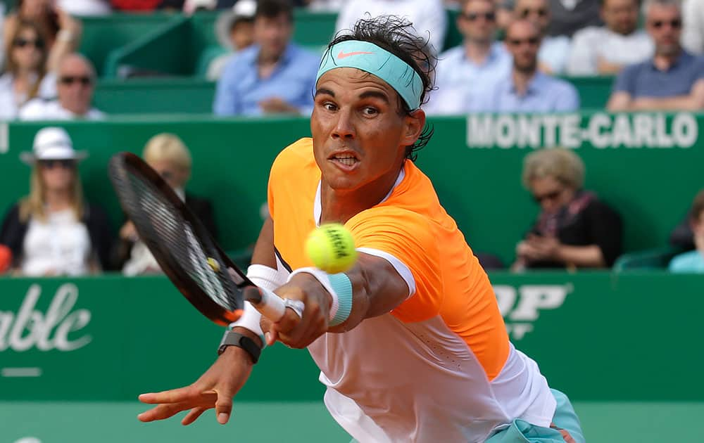 Rafael Nadal of Spain plays a return to David Ferrer of Spain during their quarterfinal match of the Monte Carlo Tennis Masters tournament in Monaco.