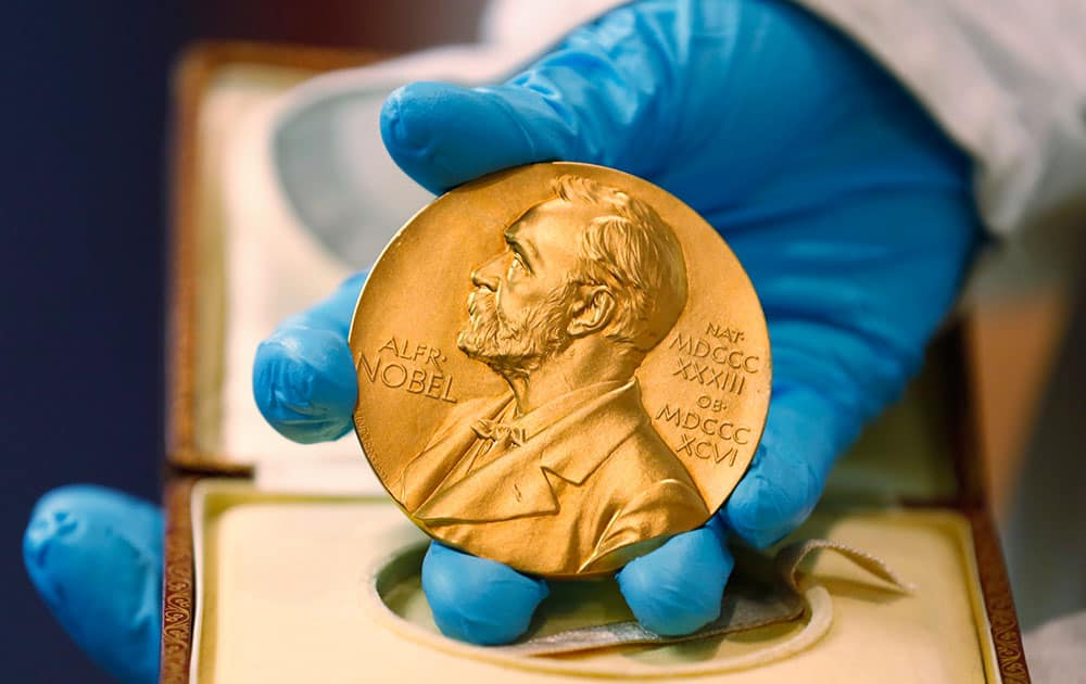 A national libray employee shows the gold Nobel Prize medal awarded to the late novelist Gabriel Garcia Marquez, on display at the National Library in Bogota, Colombia.