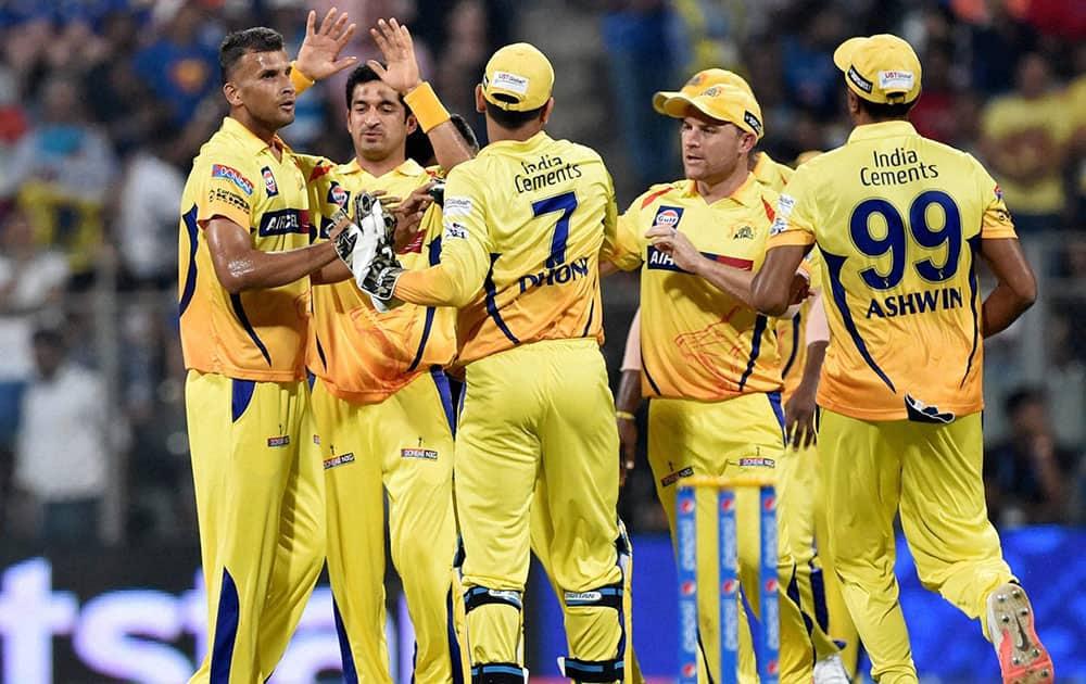 Chennai Super Kings bowler Ishwar Pandey celebrates with teammates the wicket of Mumbai Indians batsman Simmons during their IPL T20 match in Mumbai.