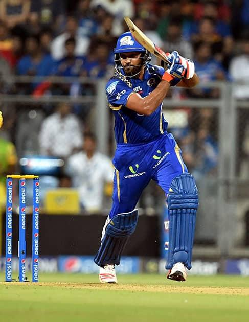Mumbai Indians batsman Rohit Sharma plays a shot against Chennai Super Kings during a IPL T20 match in Mumbai.