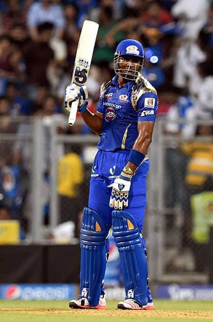 Mumbai Indians batsman K Pollard raise his bat after completes his half century against Chennai Super Kings during a IPL T20 match in Mumbai.