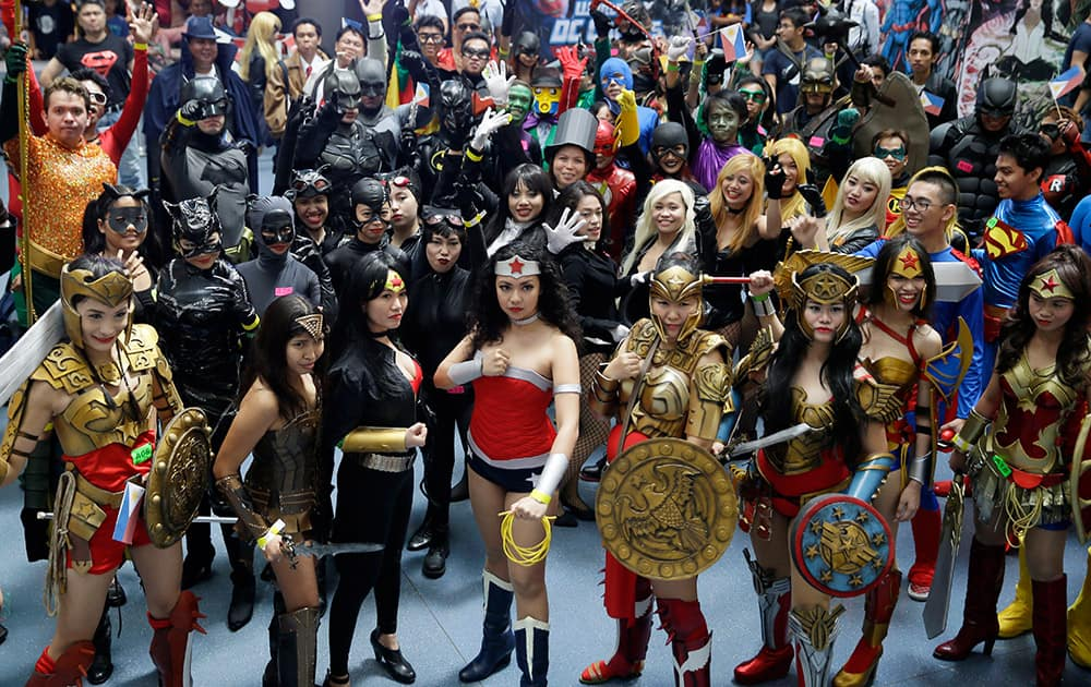 Filipino fans of DC comics super heroes pose at the country's largest shopping mall during an attempt to establish a world record for the most number wearing their costumes, at suburban Quezon city, northeast of Manila.