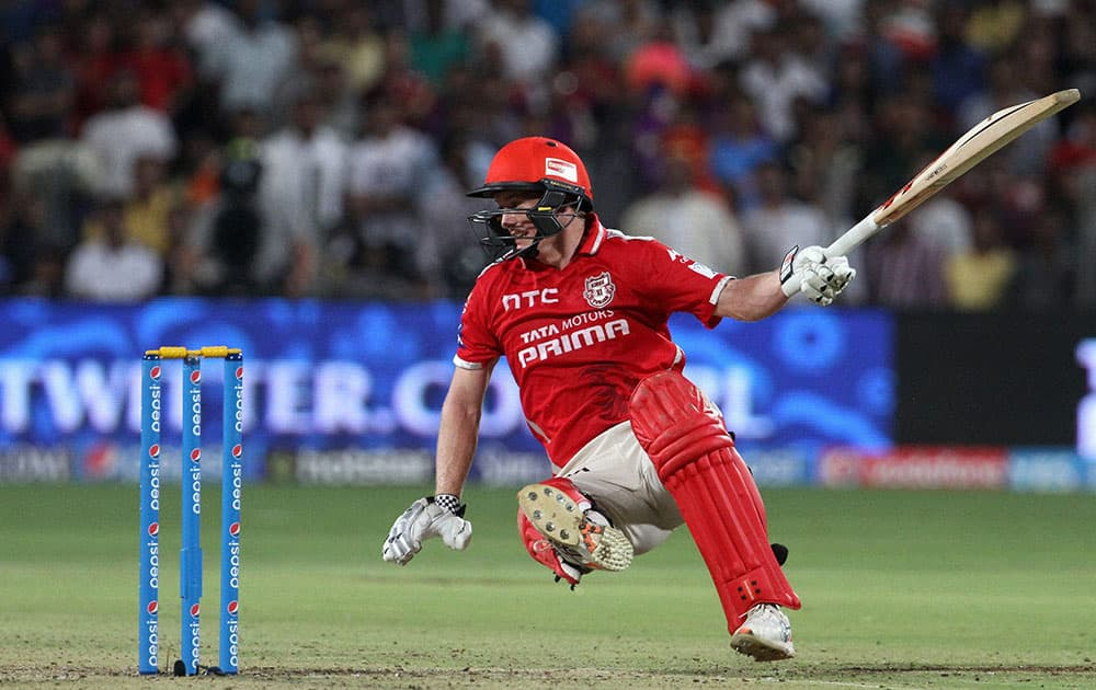 Kings XI Punjab captain George Bailey slips as he tries to plays a shot during an IPL match between KKR and KXI Punjab in Pune.