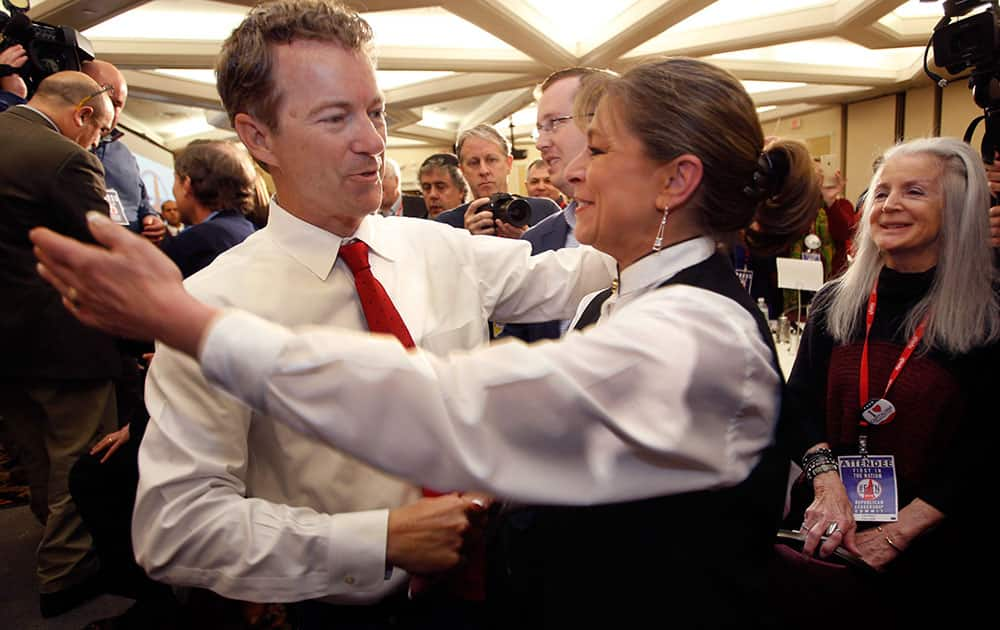 Republican presidential hopeful Sen. Rand Paul, R-Ky., gets a hug after speaking at the Republican Leadership Summit.