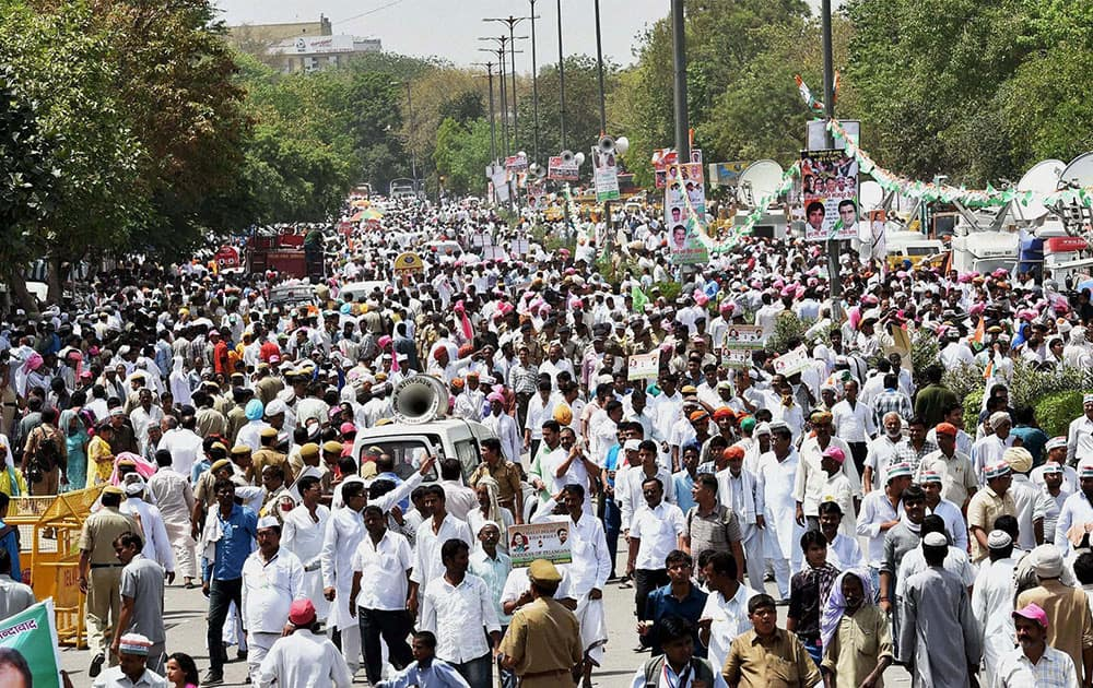 Congress Party supporters come in swarms during the farmers rally at Ramlila Maidan in New Delhi.
