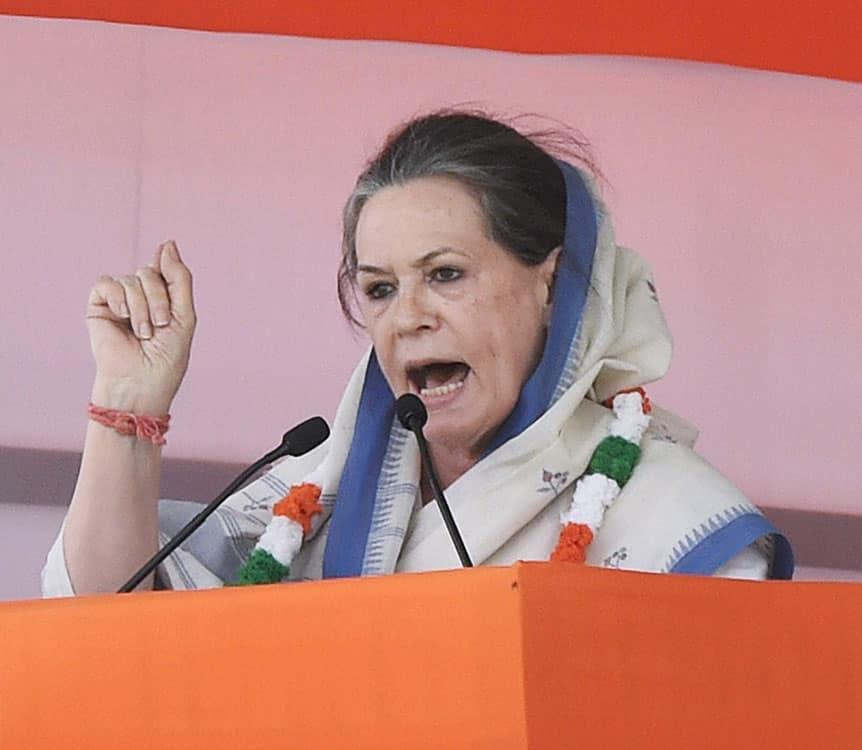 Congress President Sonia Gandhi addressing the large gathering during the farmers rally at Ramlila Maidan in New Delhi.