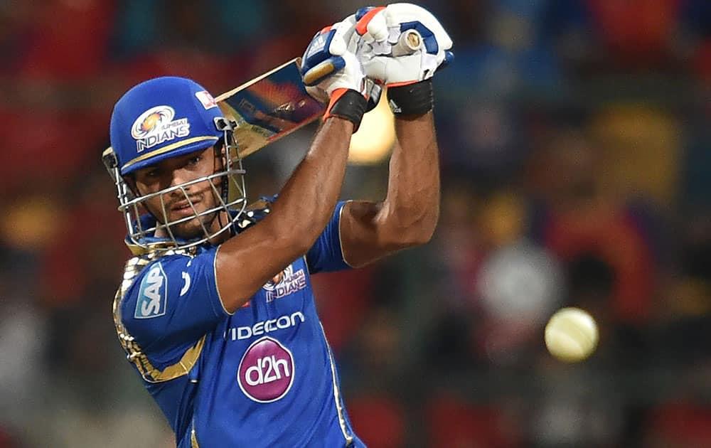 Mumbai Indians Unmukt Chand plays a shot against Royal Challengers Bangalore during IPL 8 match in Bengaluru.