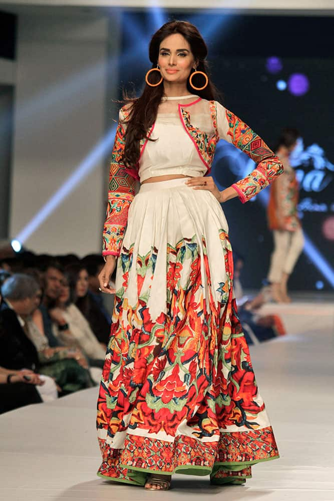 A model presents creations by Pakistani designer Hina Butt on the second-day of PFDC Sunsilk Fashion Week Spring/Summer 2015 in Lahore.