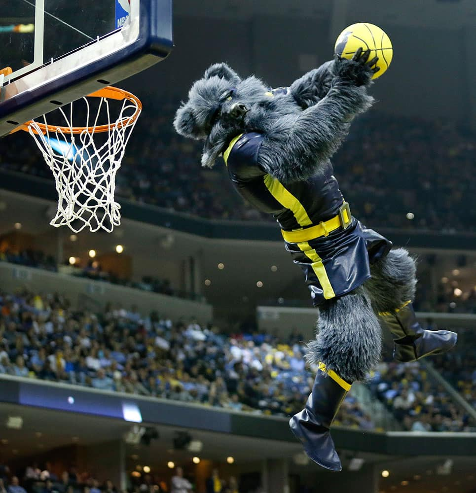 The Memphis Grizzlies' mascot dunks a ball during a timeout in the second half of Game 1 of an NBA basketball Western Conference playoff series between the Grizzlies and the Portland Trail Blazers, in Memphis, Tenn.