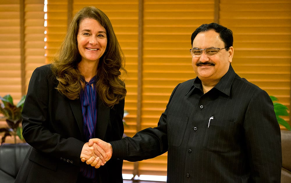 Melinda Gates, wife of Microsoft founder and billionaire philanthropist Bill Gates poses for photographers as she shakes hands with Union Minister for Health and Family Welfare Jagat Prakash Nadda in New Delhi. India conferred one of its highest civlian awards on Bill Gates and his wife Melidna for their work to promote global health and development.