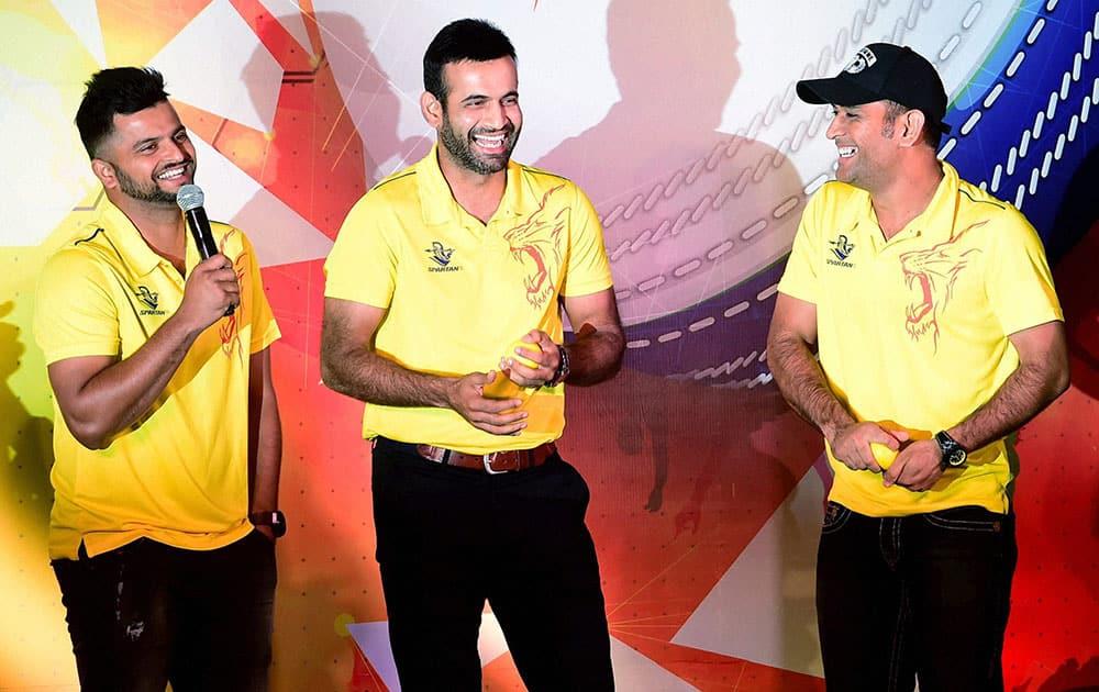 Chennai Super Kings Skipper M S Dhoni with team mates Irfan Pathan and Suresh Raina during an event in Bengaluru.