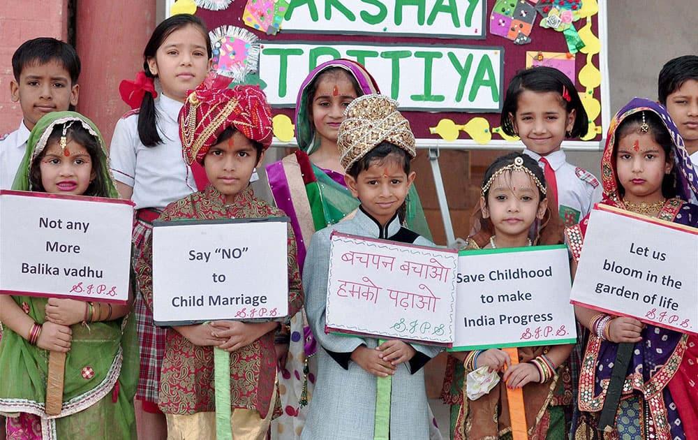 School children take part in an awareness campaign to stop child marriages on Akshaya Tritiya in Bikaner in Rajasthan.