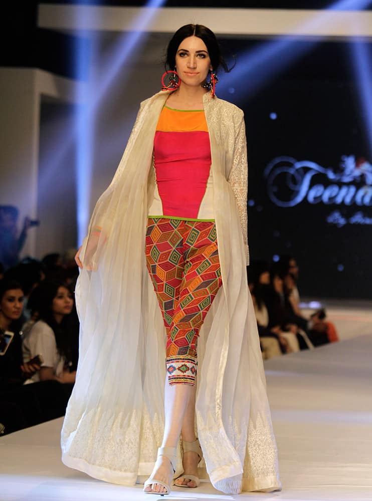 A model presents creations by Pakistani designer Hina Butt on the second-day of PFDC Sunsilk Fashion Week Spring/Summer 2015 in Lahore, Pakistan.