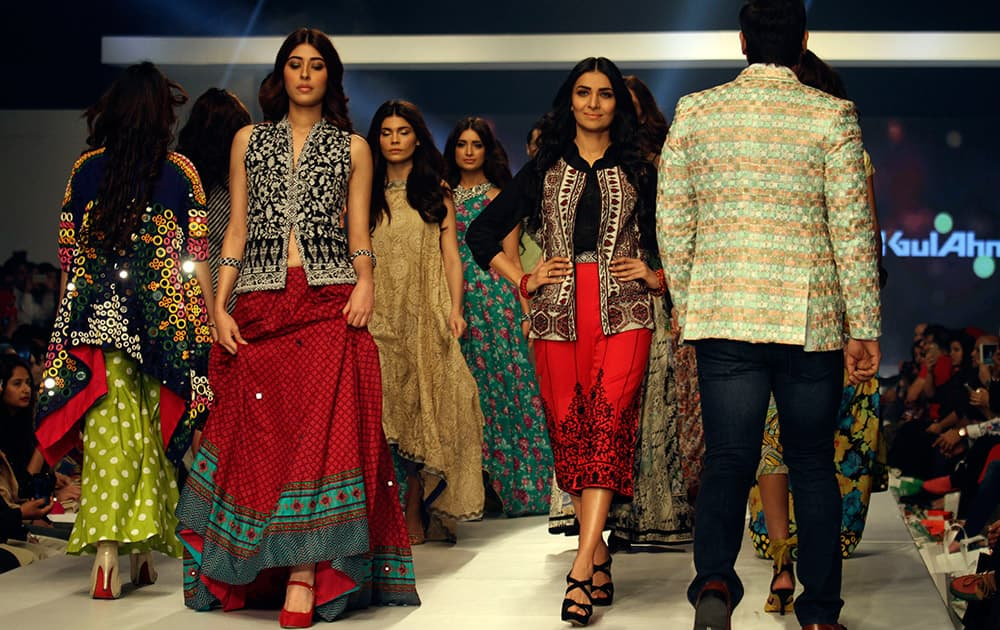 Models present creations by Pakistani designer Gul Ahmed on the third-day of PFDC Sunsilk Fashion Week Spring/Summer 2015, in Lahore, Pakistan.