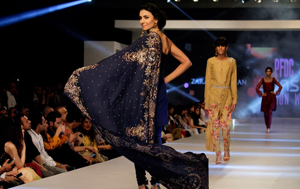 A model presents creations by Pakistani designer Zara Shajahan on the second-day of PFDC Sunsilk Fashion Week Spring/Summer 2015 in Lahore, Pakistan.