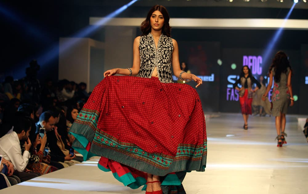 A model presents a creation by Pakistani designer Gul Ahmed on the third-day of PFDC Sunsilk Fashion Week Spring/Summer 2015, in Lahore, Pakistan.