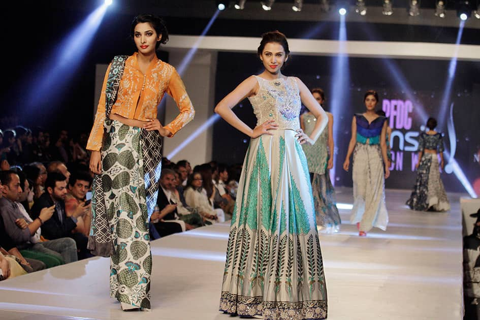 Model present creations by Pakistani designer Nida Azwer Atelier on the second-day of PFDC Sunsilk Fashion Week Spring/Summer 2015 in Lahore, Pakistan.