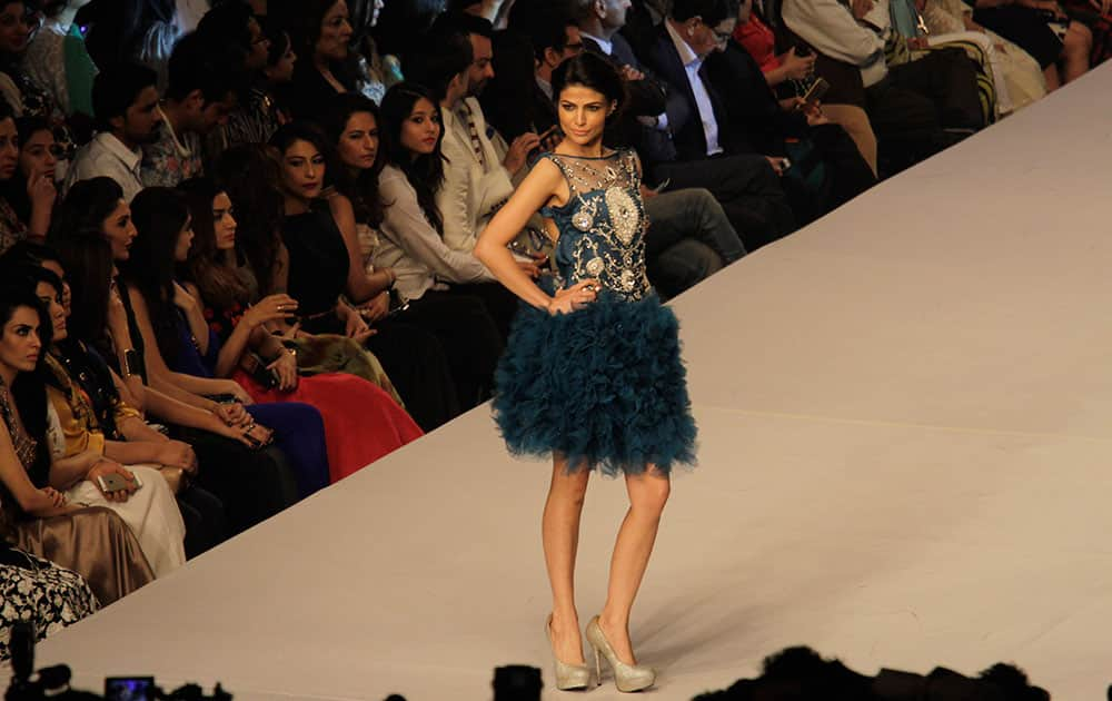 A model presents creations by Pakistani designer Syeda Amera on the last day of PFDC Sunsilk Fashion Week Spring/Summer 2015, in Lahore, Pakistan.