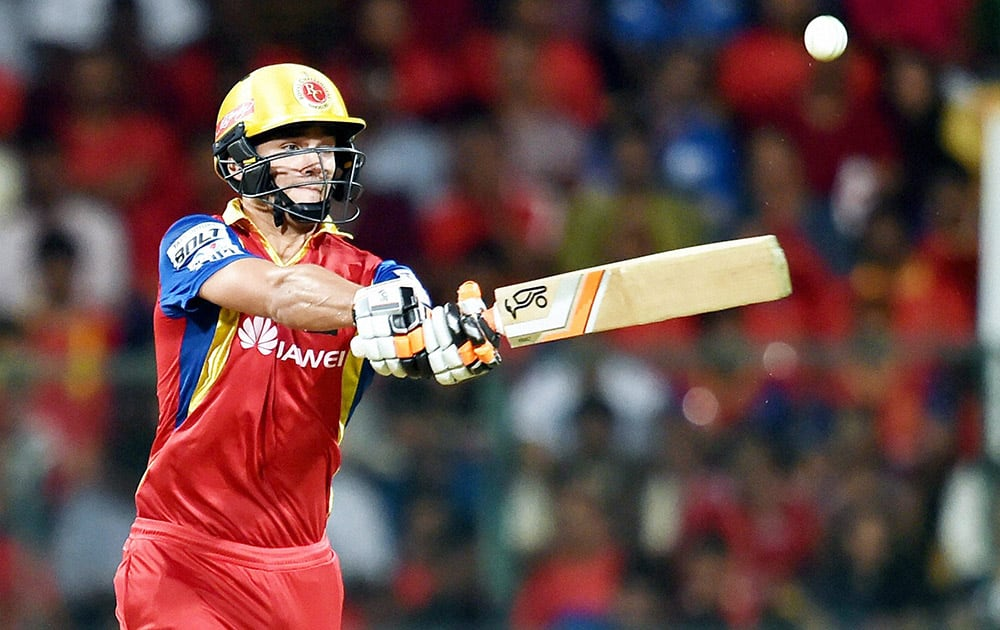 Royal Challengers Bangalore Rilee Rossouw plays a shot against Chennai Super Kings during IPL 8 match at Bengaluru.