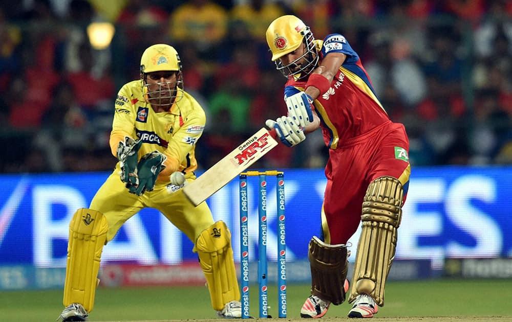 Royal Challengers Bangalore Virat Kohli plays a shot against Chennai Super Kings during IPL 8 match at Bengaluru.