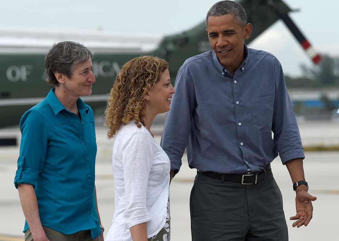 President Barack Obama walks towards Air Force One with Rep. Debbie Wasserman Schultz, D-Fla., center, and Interior Secretary Sally Jewell , left, after arriving on Marine One at Miami's International Airport.