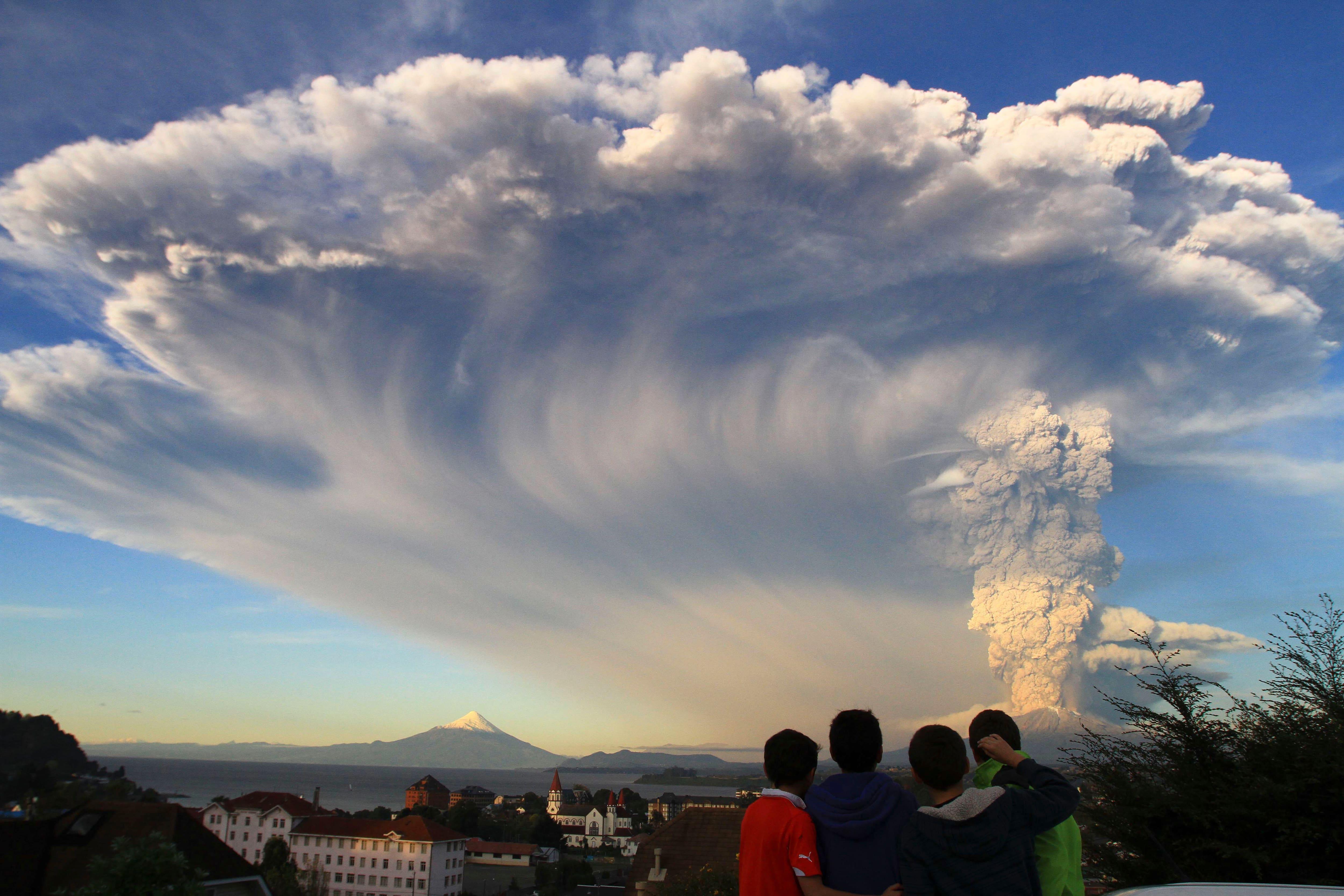 Children watch the Calbuco volcano erupt, from Puerto Varas, Chile.