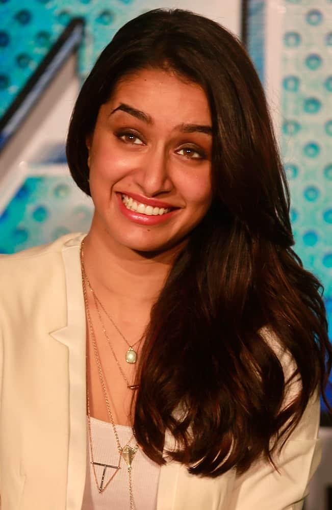 Bollywood actress Shraddha Kapoor smiles as she listens to a question from a journalist during the trailer unveiling of ABCD 2 (Any Body Can Dance 2) in Mumbai.