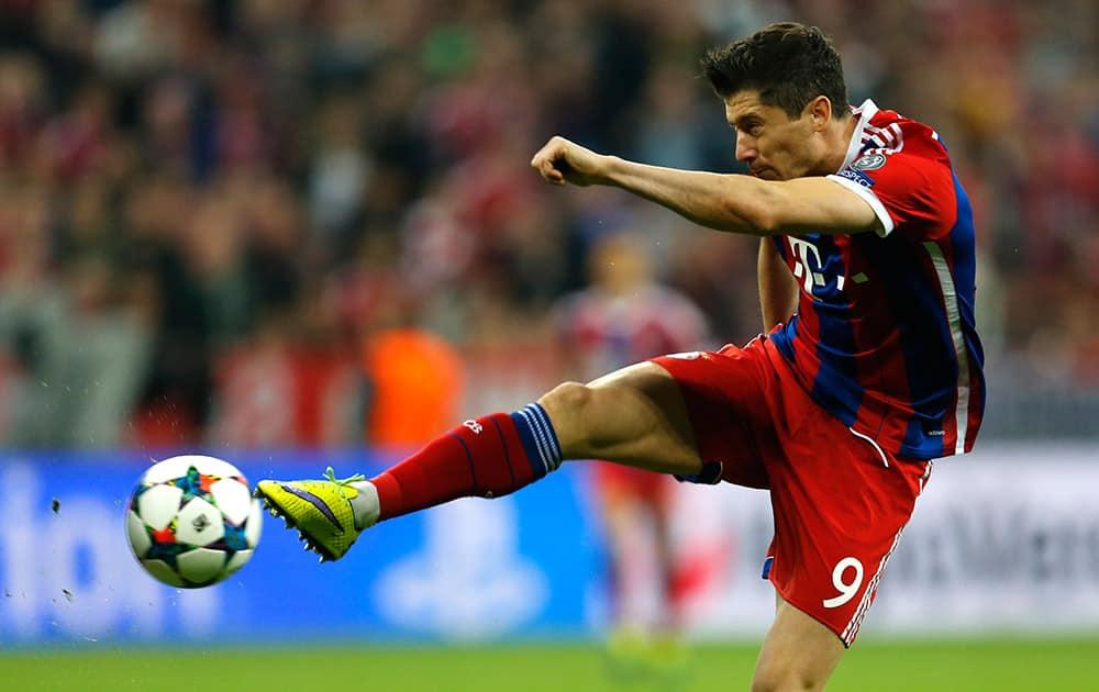 Bayern's Robert Lewandowski kicks the ball during the soccer Champions League quarterfinal second leg match between Bayern Munich and FC Porto at the Allianz Arena in Munich, southern Germany.