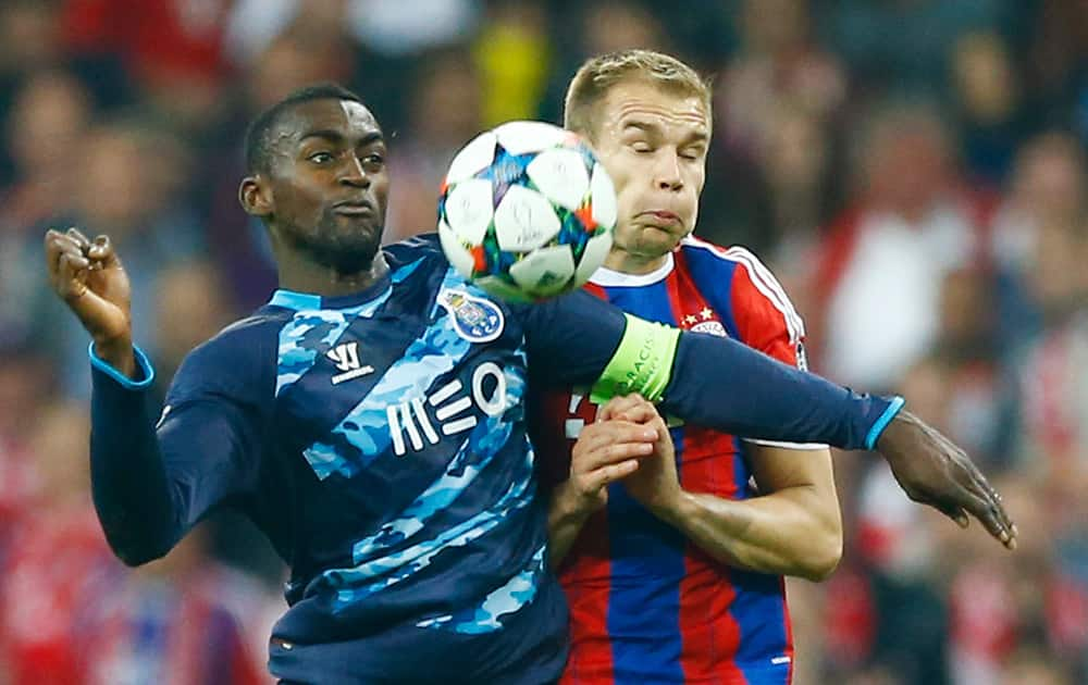 Porto's Jackson Martinez, left, and Bayern's Holger Badstuber challenge for the ball during the soccer Champions League quarterfinal second leg match between Bayern Munich and FC Porto at the Allianz Arena in Munich, southern Germany.