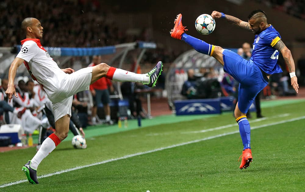 Monaco's Fabinho is challenged by Juventus' Arturo Vidal during the Champions League quarterfinal second leg soccer match between Monaco and Juventus at Louis II stadium in Monaco.