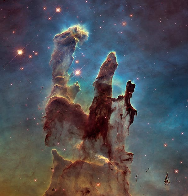 This image made by the NASA/ESA Hubble Space Telescope shows the Eagle Nebula's 'Pillars of Creation.' The dust and gas in the pillars is seared by the intense radiation from young stars and eroded by strong winds from massive nearby stars. The Hubble Space Telescope marks its 25th anniversary.