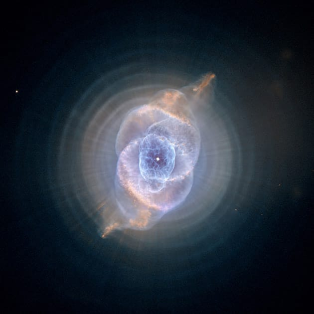 This image made by the NASA/ESA Hubble Space Telescope shows NGC 6543, the Cat's Eye Nebula. A planetary nebula forms when Sun-like stars gently eject their outer gaseous layers that form bright nebulae.