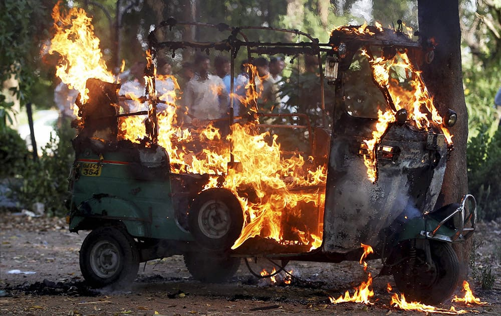 An auto rickshaw catches fire due to heat in Ahmedabad.