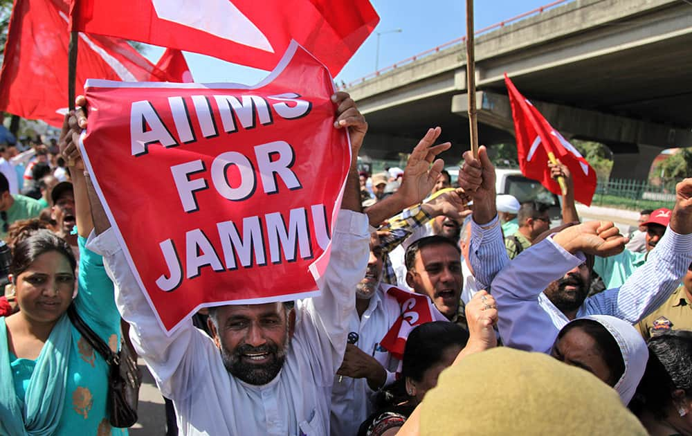 Activists of opposition National Conference (NC) party shout slogans during a protest in Jammu. Various political organizations protested against the governments' shifting of proposed health care institution All India Institute of Medical Sciences (AIIMS) from Jammu to Srinagar, the summer capital of India's Jammu-Kashmir state.