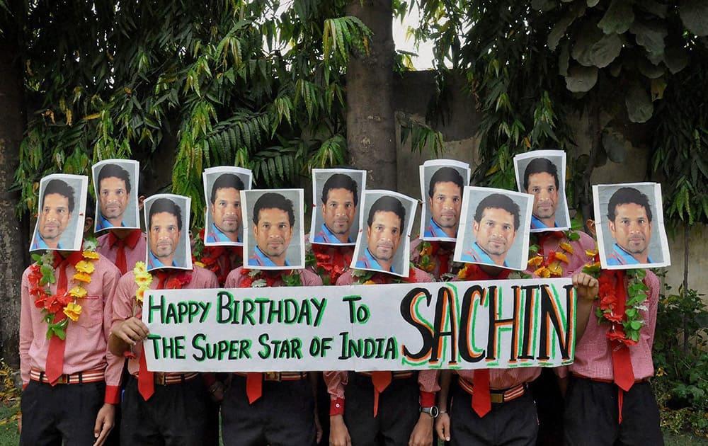 School students greet former cricketer Sachin Tendulkar on his birthday in Moradabad, Uttar Pradesh.