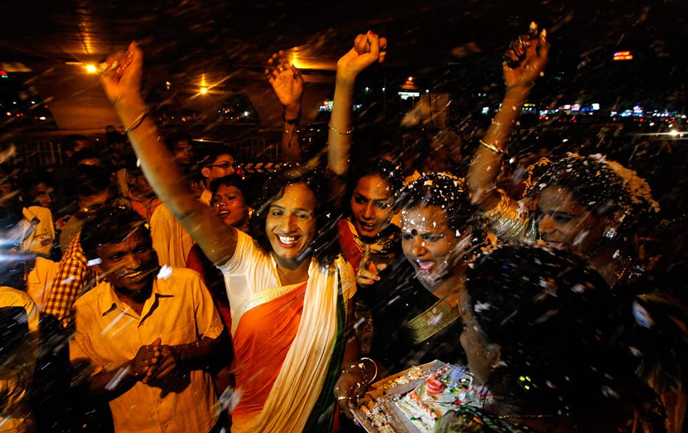 Members of the transgender community celebrate the passage of a bill seeking equal rights for transgenders in the country's upper house, in Bhubaneswar.