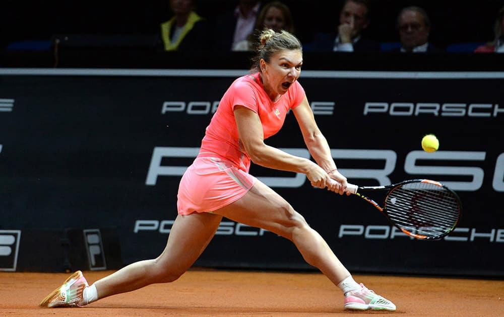 Romania's Simona Halep returns the ball to Italy's Sara Errani during their quarterfinal match at the Porsche Grand Prix tennis tournament in Stuttgart, Germany.