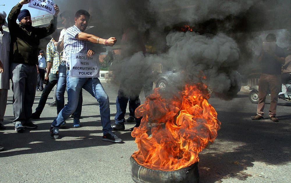 Panthers Party former MLA and workers burning tyres protesting against the government decision to give AIIMS to Kashmir which was originally offered to Jammu.