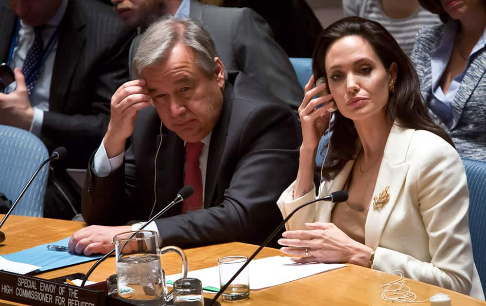 U.N. Special Envoy for Refugees and Hollywood star Angelina Jolie, right, and U.N. High Commissioner for Refugees António Guterres, left, brief the U.N. Security Council on Syria's refugee crisis.