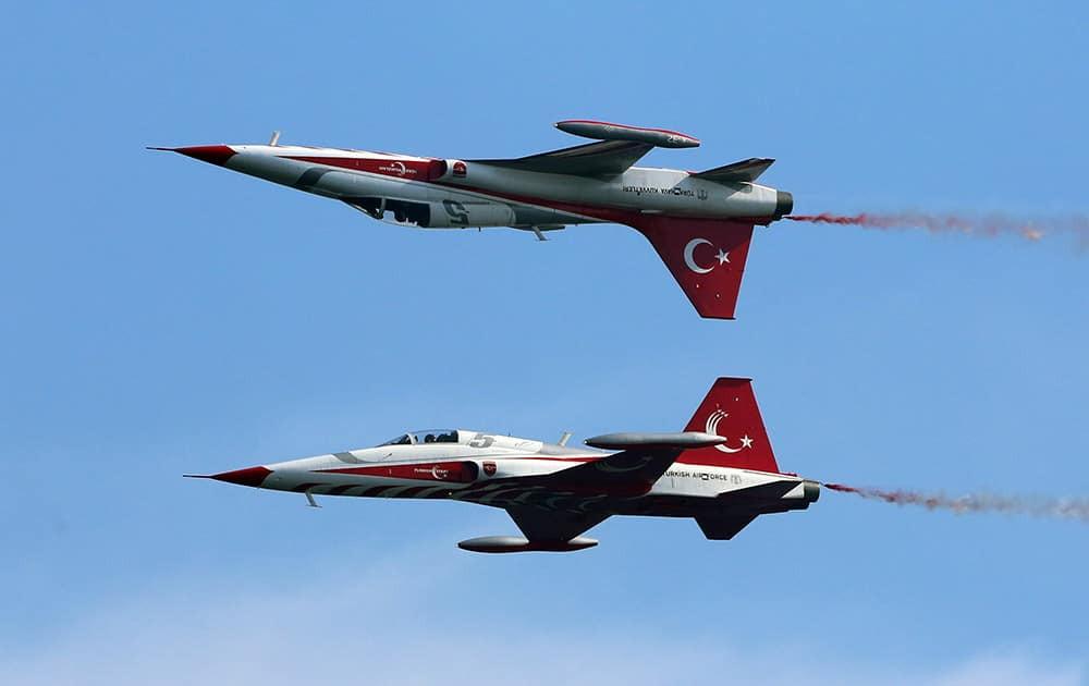 The Turkish army's aerobatic demonstration team, the Turkish Stars, perform with their supersonic jets during the Turkish International Service at Mehmetcik Abide in the Gallipoli Peninsula, Turkey.