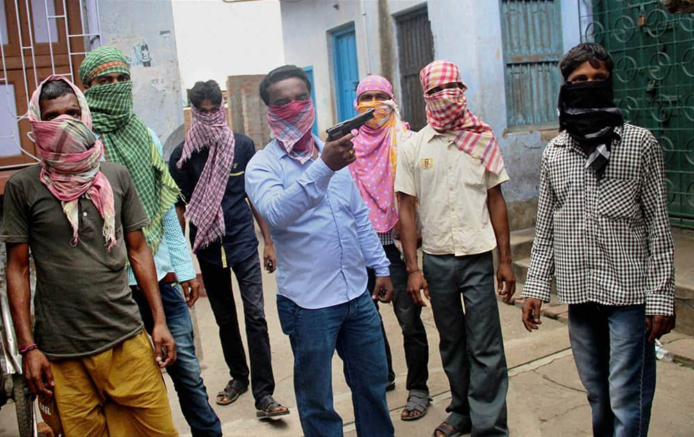 Hooligans threat media with a weapon near a polling booth during Municipal elections at Katwa in Burdwan district.
