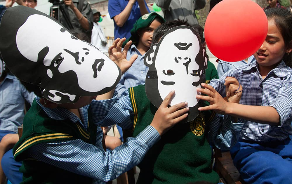 Exile Tibetan school children wear masks of Gedhun Choekyi Nyima, the Panchen Lama chosen by Dalai Lama, to mark his 26th birthday in Dharmsala. Panchen Lama, the second highest leader in Tibetan Buddhist hierarchy, who has not been seen since 1995.